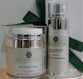Skin Comfort Kit from Skin Essentials, Wexford close up pic. Oncology safe oil and cream in a white gift box with green ribbons.