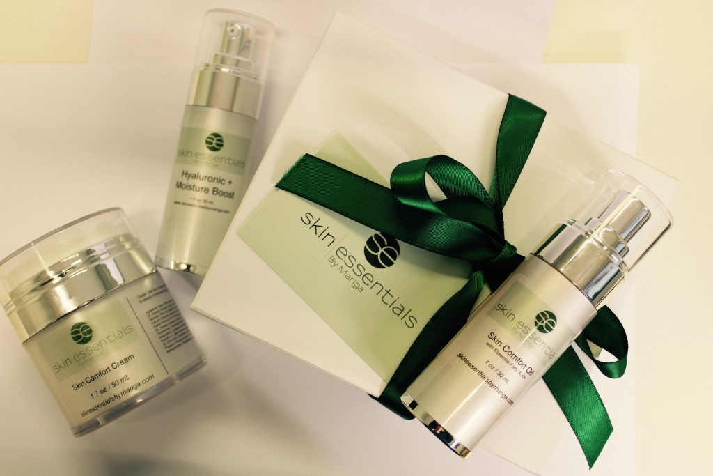 A styled photo of Skin Essentials by Mariga products in a white magnetic box tied with green ribbon on a white background which are available online or from our Wexford town skin clinic