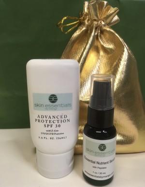 Skin Essentials by Mariga SPF30 75ml and Essential Nutrient Serum 30ml in a gold satin bag
