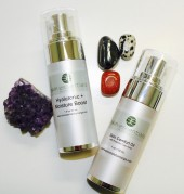 Pic of skin comfort oil and hyaluronic boost serum from skin essentials by mariga wexford, airless pump bottles styled with natural crystals